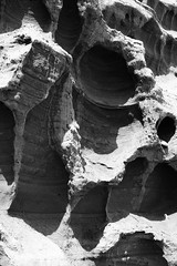 Martian Landscape (Frog n fries) Tags: blackandwhite cliff abstract beach shadows holes devon budleigh anotherplanet recesses