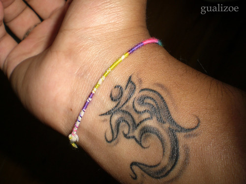Ohm wrist tattoo; ← Oldest photo