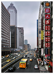 asian new york (staffh) Tags: china city urban building bus tower colors yellow architecture skyscraper asian asia colours skyscrapers cab towers central wide taiwan yellowcab kong staff metropolis taipei tall   shanghaiist 7eleven shinkonglifetower shin density dense  urbanity shinkong taibei