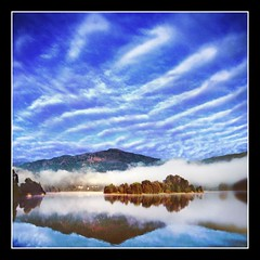 Magical Morning (adrians_art) Tags: morning blue autumn trees sky white mist water misty fog clouds reflections geotagged dawn landscapes bravo grasmere lakes cumbria soe naturesfinest geotags blueribbonwinner splendiferous instantfave outstandingshots outstandingshot shieldofexcellence platinumphoto superaplus aplusphoto holidaysvacanzeurlaub superbmasterpiece favemegroup6 diamondclassphotographer bratanesque thegoldenmermaid