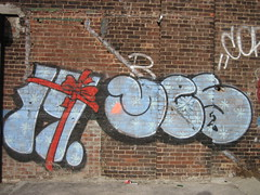 Merry Christmas From Me and Miss 17! (Becki_Fuller) Tags: christmas street nyc streetart brooklyn photography graffiti yes seasonal gift bow williamsburg nework miss17