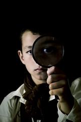 Odd boy (e.v.r.i.e.l) Tags: boy portrait eye face dark kid eyes child zoom magnifyingglass odd sombre enfant bizarre gamin magnifier visage garon loupe droll