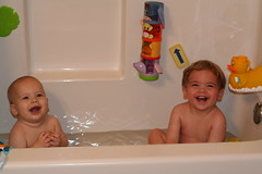 Both boys in the tub