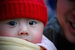 Pink Cheeks & Bright Eyes (Michael Steverson) Tags: china park pink boy red fab baby cold cute beautiful hat proud asian happy eyes dad bright knit games explore cheeks chinadigitaltimes allrightsreserved guangxi expatriate liuzhou expatriategames