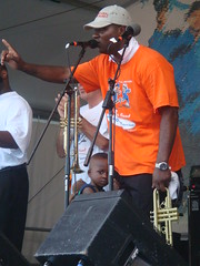 Clinging (Queens Metal) Tags: neworleans father jazzfest brassband