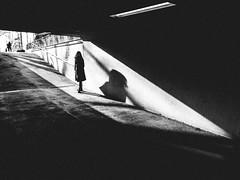 solar surfing (matthias hämmerly) Tags: zuerich zürich street streetphotography grain light shadow contrast subway woman ricoh grd 2 switzerland swiss sun sunbeam dark monochrome black white