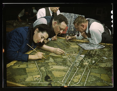 Camouflage class in New York University, where men and women are preparing for jobs in the Army or in industry, New York, N.Y. They make models from aerial photographs, re-photograph them, then work out a camouflage scheme and make a final photograph (LOC