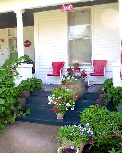 Retro red chairs in a front porch, via Flickr: jipsi