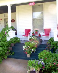 Late Summer Porch (jipsi) Tags: wood flowers red summer green window garden illinois chair country cottage steps victorian entrance motel retro container oldhouse pots veranda american hanging flowerpot geraniums planter frontporch petunias bouncy entry fouroclocks metalchair