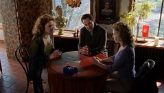 Adrian Monk watch a psychic read tarot cards
