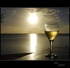 Chardonnay Sunset (heritagefutures) Tags: ocean sea copyright white holiday reflection beach water gold islands drops waves wine pearls southpacific condensation hr northern waterdrops whitewine commonwealth dirk guam gitzo mariana allrightsreserved chardonnay saipan dropsofwater micronesia marianas marianaislands goldenglow glassofwine cnmi northernmarianaislands spennemann nikond80 commonwealthofthenorthernmarianaislands heritagefutures dirkhrspennemann southpacificbeaches copyrightdirkhrspennemann ausphoto