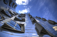 Looking Up at Gehry (WrldVoyagr) Tags: city blue reflection building architecture clouds germany deutschland fire day gehry exhibit moo 500v50f dusseldorf 1000v100f dsseldorf frankgehry hdr medienhafen 3xp 555v5f 1111v11f 444v4f photomatix 777v7f 999v9f tonemapped 888v8f tonemapping 666v6f 5elements gehrybauten barcelonaphotobloggers moocards twip pwpartlycloudy