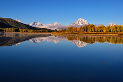 Oxbow Bend Silken Glass (Fort Photo) Tags: reflection nature river landscape nikon bravo d70 nps smooth vivid snakeriver wyoming teton tetons grandteton wy onblue grandtetonnationalpark firstquality oxbowbend 50faves abigfave megashot fakedvelvia multimegashot