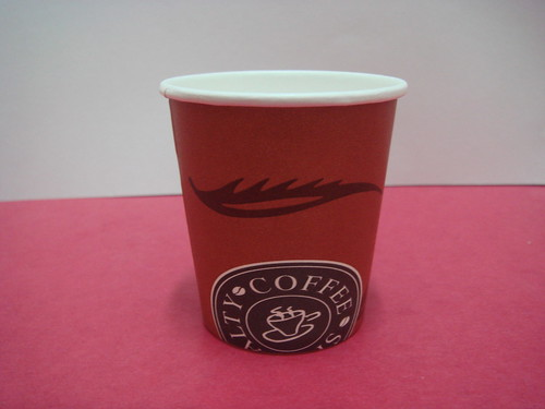 flat bottom un-waxed paper cup, filled with water