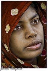 Gravity (Jamal Alayoubi) Tags: street red portrait woman india face yellow nikon muslim poor arab 200 28 kuwait d200 nikkor 70 vr jamal littlestories bangladish alayoubi picswithsoul