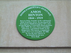 Photo of Amos Hinton green plaque
