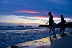Sun setting on Serendipity (Keith Kelly) Tags: city sunset sky people beach water night clouds festive boats lights evening coast town asia cambodia sihanoukville southeastasia surf waves break gulf dusk coastal tropical kh breakers kampuchea ochheuteal kampongsom serendipitybeach sihanoukvillesihanoukville