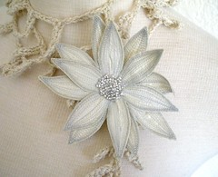 Lotus Flower Lariat- Cream (Betsie Withey) Tags: motion flower art mi spring pretty lily lotus embroidery michigan unique brooch crochet cream free elf fantasy lariat etsy wearable fiberart rowan beading beaded saugatuck summertweed barrette seedbeads arttowear fiberjewelry artscarf fibernecklace scarfscarflette