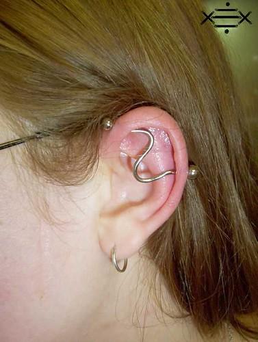 industrial ear piercing. 14g curved industrial piercing