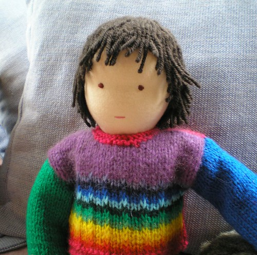 Yeshi's doll and his rainbow jumoer