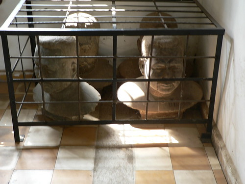 Caged busts of Pol Pot