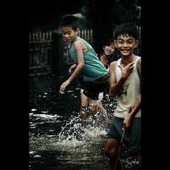 Flooded with Joy (Soul101) Tags: life street people water children play flood joy streetphotography actionshot nikond40 soul101