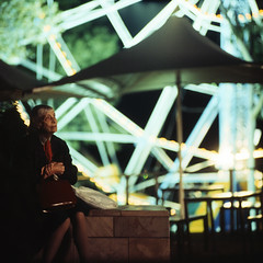 ex memoria (memetic) Tags: old city urban woman 120 6x6 wheel night mediumformat square lights sitting kodak bokeh tl melbourne ferris federation p6 pentaconsix sonnar 180mm epl 400x unsensored08exhibitedwork