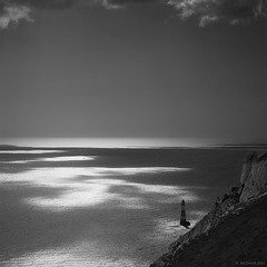 Beachy Head lighthouse (redux) (Jon Downs) Tags: uk england lighthouse white black art digital canon downs landscape creativity eos grey coast photo jon flickr artist image united gray creative picture kingdom pic photograph eastbourne portfolio eastsussex southdowns beachyhead waterscape 400d jondowns