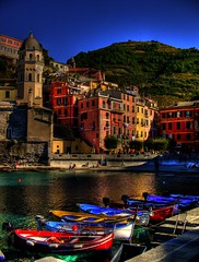 Day 13: Cinque Terre - Vernazza06 (aaronsigfin) Tags: blue sea sky italy mountains beach buildings boats harbor town colorful europe mediterranean honeymoon amy hiking aaron cliffs trail terre vernazza hdr cinque breakwater thatsclassy