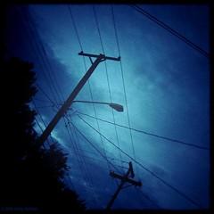 untitled (Full Metal Photographer) Tags: cloud storm rain holga wire streetlight nebraska lincoln telephonepole lincolnnebraska fineartphotography fakeholga holgascript kellyhoffart