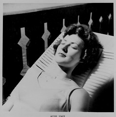 mom sunbathing (igo2cairo) Tags: 1960s sunbathing