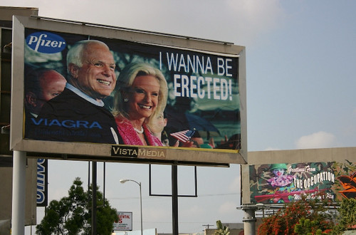 Billboard hijacked by Ron English - I want to be erected