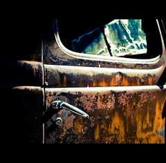Distillery (robert_goulet) Tags: lighting door old light toronto ontario canada art texture abandoned window composition truck handle lumix rust shadows close district perspective may rusty olympus panasonic rusted installation micro 17 weathered pancake 20mm windshield distillery crusty dilapidated ep1 2011 m43 mft fourthirds mikecrough