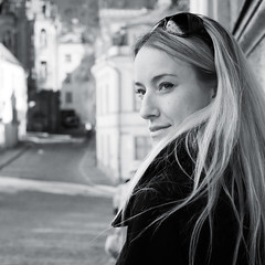 Diana at Old town, Tallinn (Estonia) (Mikko Miettinen) Tags: portrait blackandwhite bw woman beautiful sunglasses square tallinn estonia watching diana blond blonde finnish oldtown eesti tallinna estonian intenselook vanalinn vanhakaupunki blackcoat harju
