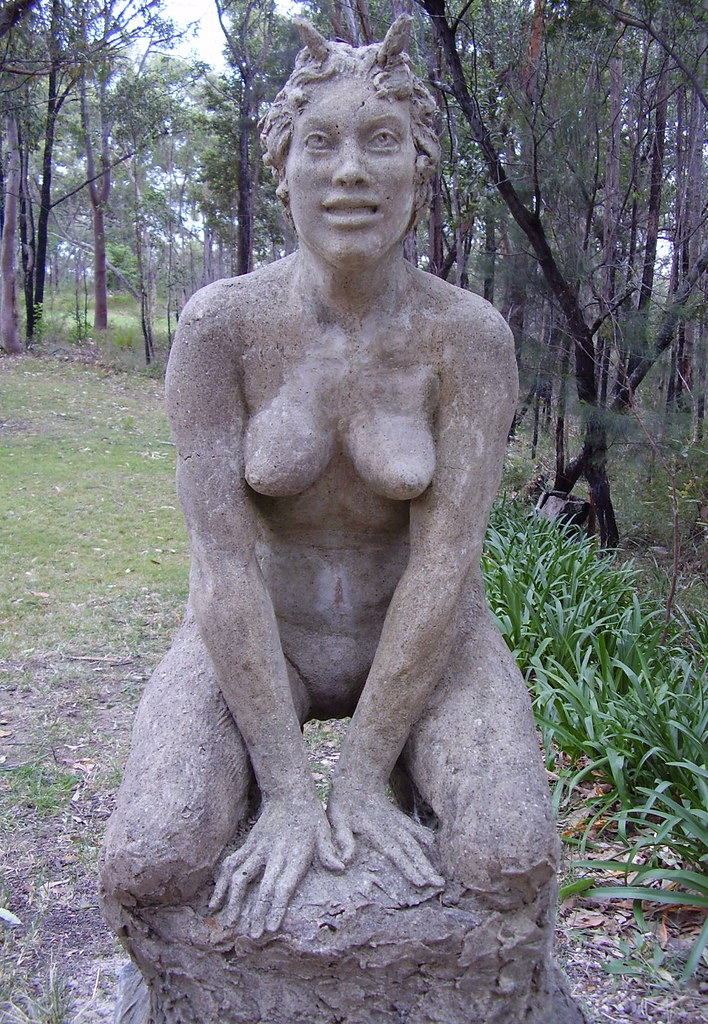 Nude statue of woman with horns