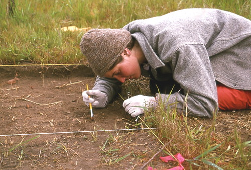 Excavating beads during archaeological investigations at the old Champoeg townsite at Champoeg State Park (Oregon, USA), 1975