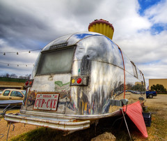 The Cup Cake Airstream of Austin (Stuck in Customs) Tags: pictures panorama reflection art lines modern clouds work austin photography intense nikon shoot texas photographer shot angle superb photos modernart south details perspective images best creepy congress cupcake edge stunning pro capture airstream picturesque siren hdr southcon