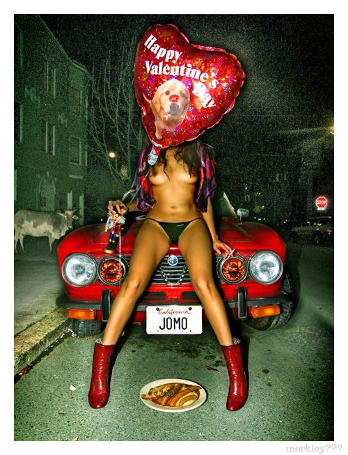 """Sylvia - Sending Mixed Messages With a Nut Cracker, a Face Blocking """"Puppy With Kiss"""" Valentines Balloon, Jewish Underpants, German Wieners & a Cigarette While Un-Lady-Like Posing On a Very Romantic Italian Car With """"JOMO"""" (Spanish for HOMO) Vanity Plates"""