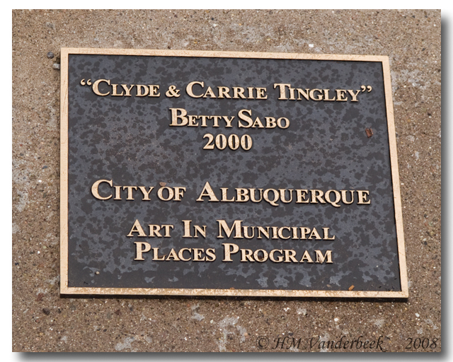 Plaque At Foot of Statues