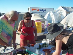 Preparing the Last Supper (Kshandra) Tags: dylan terminalcity burnbaby burningman2008 zulegoona