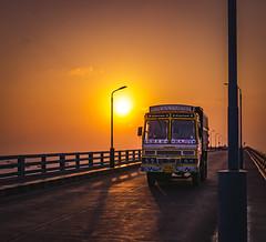 Sunset at Pamban Bridge, Ramewsaram (ashwin647) Tags: indiapictures india tamilnadu rameswaram bridge sunset goldenhour sky dawn evening road lorry pambanbridge dhanuskodi