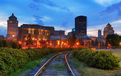 on the tracks to the Old Montreal (David Giral | davidgiralphoto.com) Tags: longexposure blue sky chien canada david skyline night train landscape lights evening nikon cityscape quebec dusk montreal hour entre loup bluehour d200 et hdr heure giral magique nikond200 18200mmf3556gvr entrechienetloup copyrightdgiral davidgiral