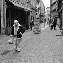 Liege (Peter Gutierrez) Tags: street old city houses people urban bw white black streets film public shop contrast square town photo europe european belgium belgique belgie pavement centre belgi center cobblestones sidewalk peter shops gutierrez format belgian cobbles liege narrow centrum luik contrasty lige wallon wallonie wallonia liegois superhearts wallone photofaceoffwinner petergutierrez liegoises liegoise ligois ligoise ligoises