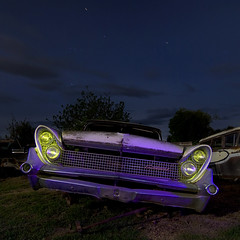 Canted Canter (Lost America) Tags: lightpainting abandoned night continental fullmoon lincoln junkyard 1959 nocturnes thebigm