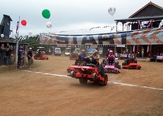Willie nelson s first annual bad boy and bad girl lawn mower race