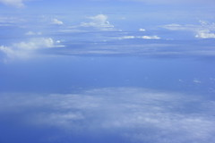 Blue sky (Swami Stream) Tags: ocean blue sea india window clouds canon airplane rebel indian indianocean flight swami swaminathan aircraftwindow xti swamistream swamistreamcom