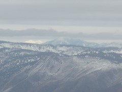 Stormy, Hardy, and Forest Mountains and far to the left in white mountains in the Sawtooth area across Lake Chelan.