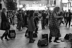 Shinjuku street performer (F_blue) Tags: bw tokyo nikon shinjuku f delta3200 ilford 50mm12  fblue2008