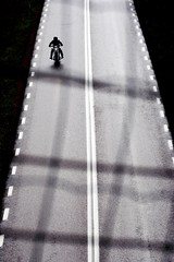 On the road to Uffe P Berget  Rob Watkins 2005 (Aland Rob) Tags: road light shadow people white lines bike tarmac speed fence finland pattern sitting mesh perspective double p riding shade sit motorcycle biker lonely straight seated rider uffe leathers aland berget godby photographrobwatkins