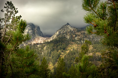 glimpse of storm peak through the trees (Christian Collins) Tags: rocky glimpse glimpseviewgappass wyoming grand teton national park storm peak trees clouds sun mountains rockies trail view pines canoneosrebelt2i